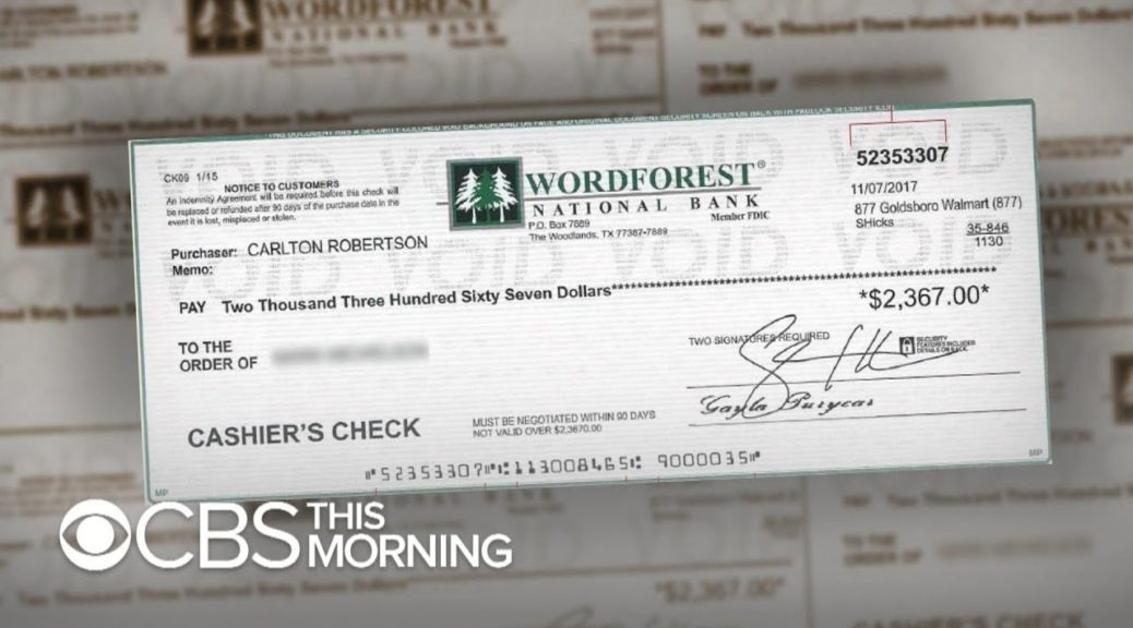 """Fake check scams """"exploding epidemic,"""" new report says"""